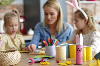 Accessories to make Easter decorations and family in the background