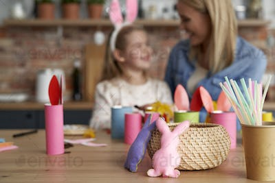 Handmade Easter rabbits and mom and daughter in the background