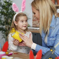 Mother and daughter preparing Easter decorations at home