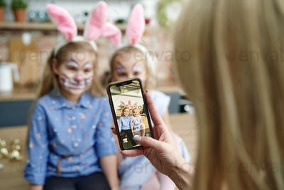 Mother takes photo of daughters dressed up as Easter bunnies