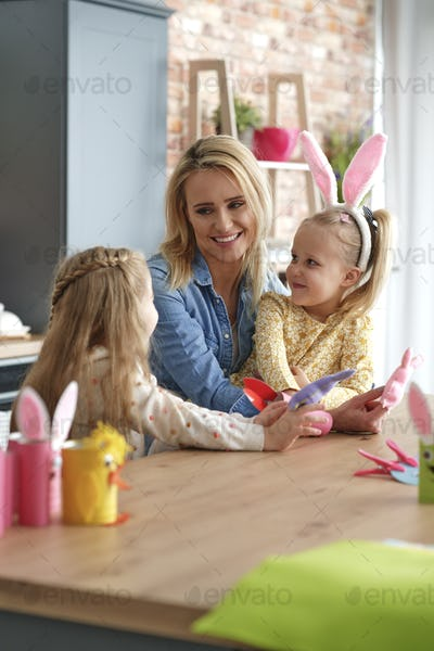 Happy mom and two little daughters in Easter time