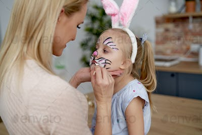 Face painting for little Easter bunny at home
