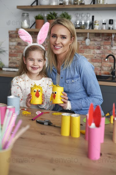 Portrait of mother and daughter with handmade Easter chickens
