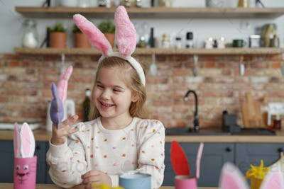 Happy girl have fun with Easter puppets