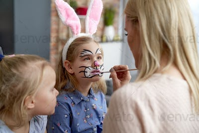 Close up of face painting for little Easter bunny at home