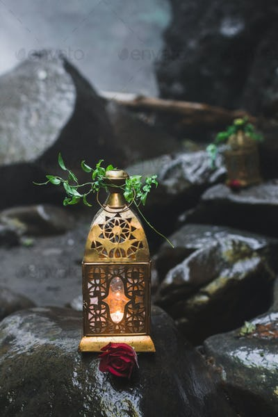 Evening wedding ceremony with vintage forged lamps and candles inside