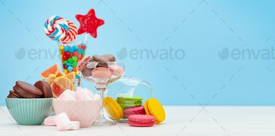 Various sweets in cocktail glasses