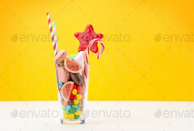 Various sweets assortment in cocktail glass