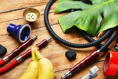 Smoking shisha with banana tobacco