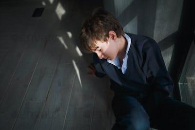 Pensive sad teenager boy.