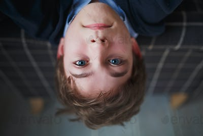 A boy teenager with blue eyes.