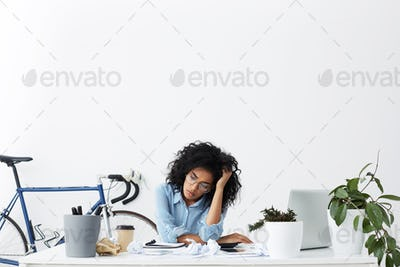 People, business and modern technology. Sad beautiful female secretary looking unhappy, having a lot