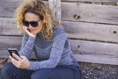 Attractive woman in mountain trekking clothes use modern phone device internet connected