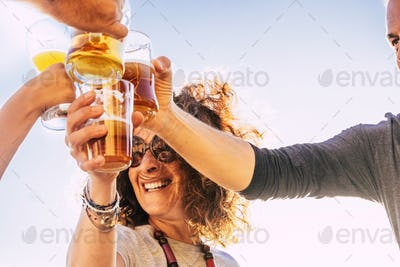 Close up of people toasting and clinking together with happy and joy and having fun