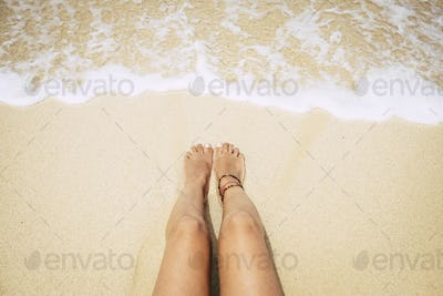 woman lying on the caribbean yellow sand near the transparent water. concept of vacation