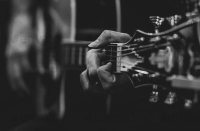 Playing classic guitar. Selective focus.