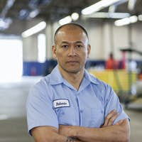 Portrait of Pacific Islander car mechanic in auto repair shop