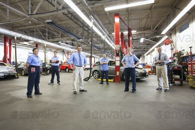 Portrait of Six Mechanics in Auto Repair Shop viewed from above