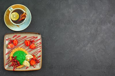 top view delicious cake with cup of tea on dark background tea sweet sugar dessert