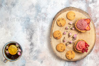 top view delicious creamy cakes with tea on a light background candy photo biscuit sweet