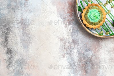 top view little creamy cake with fruits inside tray on the light background biscuit sweet photo