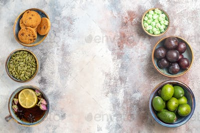 top view fresh fruits with cup of tea on light background tea photo dessert