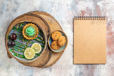 top view little creamy cake with fruits on light background biscuits candy photo sweet