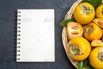 top view fresh sweet persimmons inside basket on dark background mellow fruits ripe tree