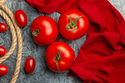 top view red cherry tomatoes with ropes on a light background ripe photo salad food