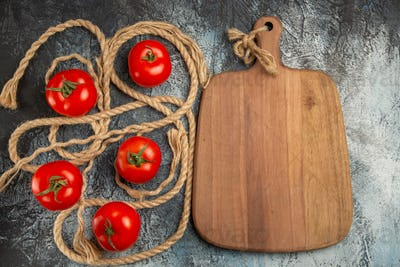 top view fresh red tomatoes with ropes on dark background ripe photo salad