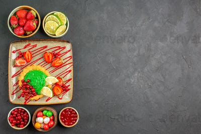 top view delicious cake with candies and fruits on dark background sweet sugar dessert tea