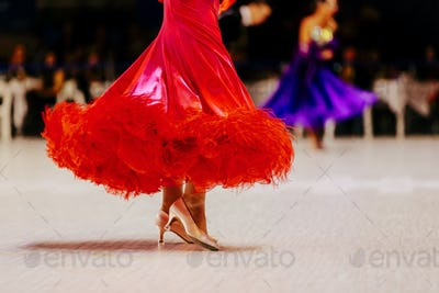 female dancer in red ball gown