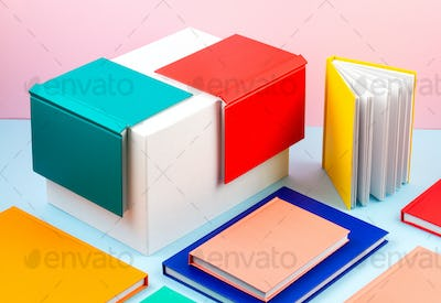 Colorful notebooks over the blue pastel background. Modern abstract working space