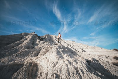 young boy explorer on a white rock