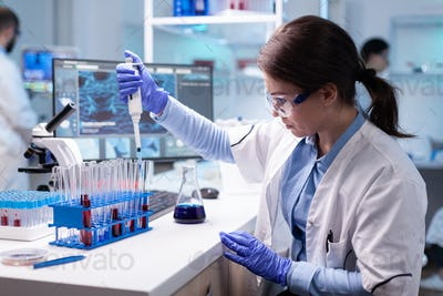 Concentrated professional woman scientist in laboratory