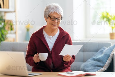 woman with a paper receipt