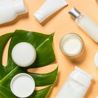 Natural cosmetic products at color background.