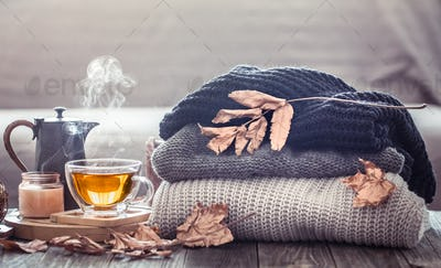 Cozy autumn still life with a cup of tea