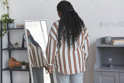Overweight African American Woman Looking in Mirror Back View