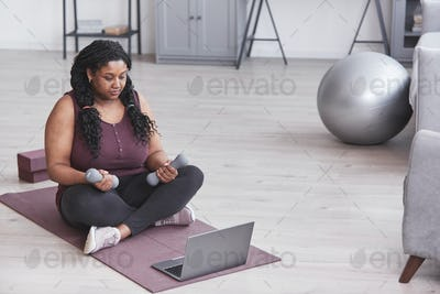 Overweight African American Woman at Home Workout