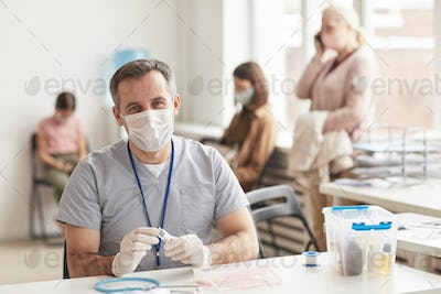 Mature Male Doctor in Vaccination Center