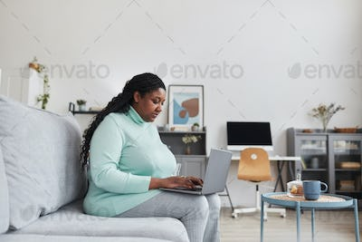 Overweight African American Woman Using Laptop at Home