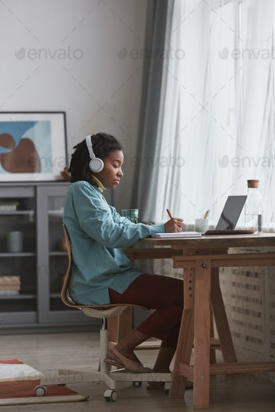 Real African American Woman Studying at Home