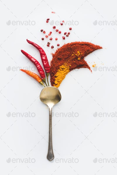 top view of spoon with beautiful peppers composition isolated on white
