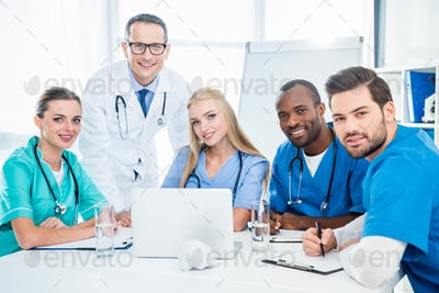 team of doctors and general practitioner having conversation