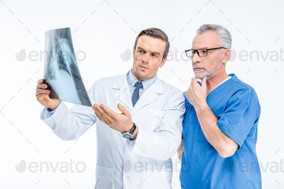 Two male doctors examining x-ray image isolated on white