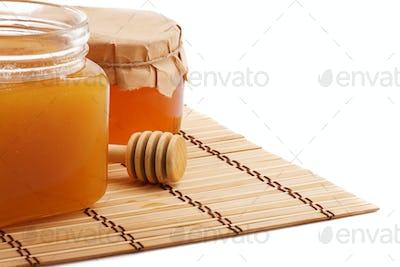 isolated pots of honey isolated on white