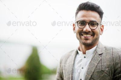 Stylish pakistani man wear in eyeglasses and jacket.
