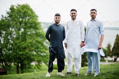 Group of pakistani man wearing traditional clothes salwar kameez or kurta.