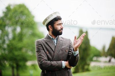 Beard afghanistan man wear pakol hat and jacket.
